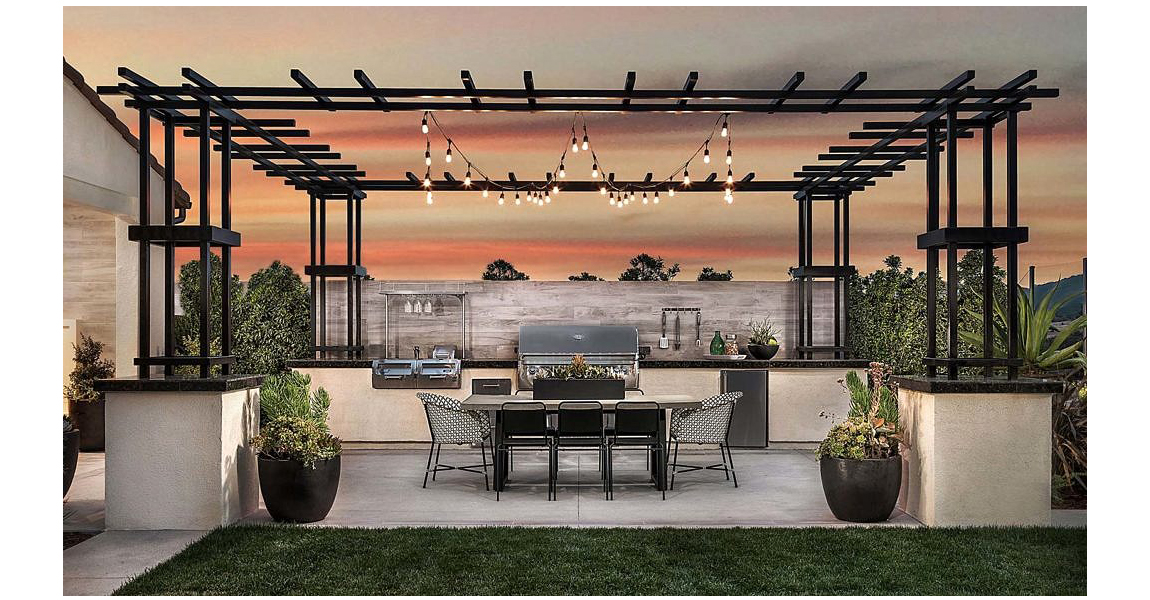Outdoor kitchen with pergola, table and light