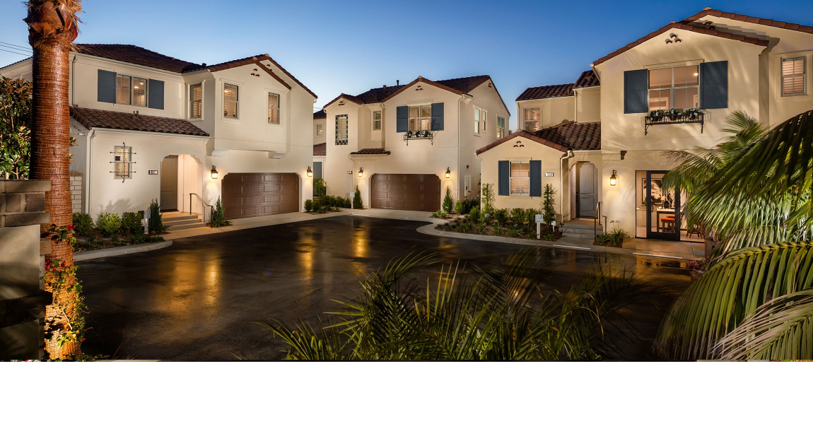 3 large house with lights and palm trees