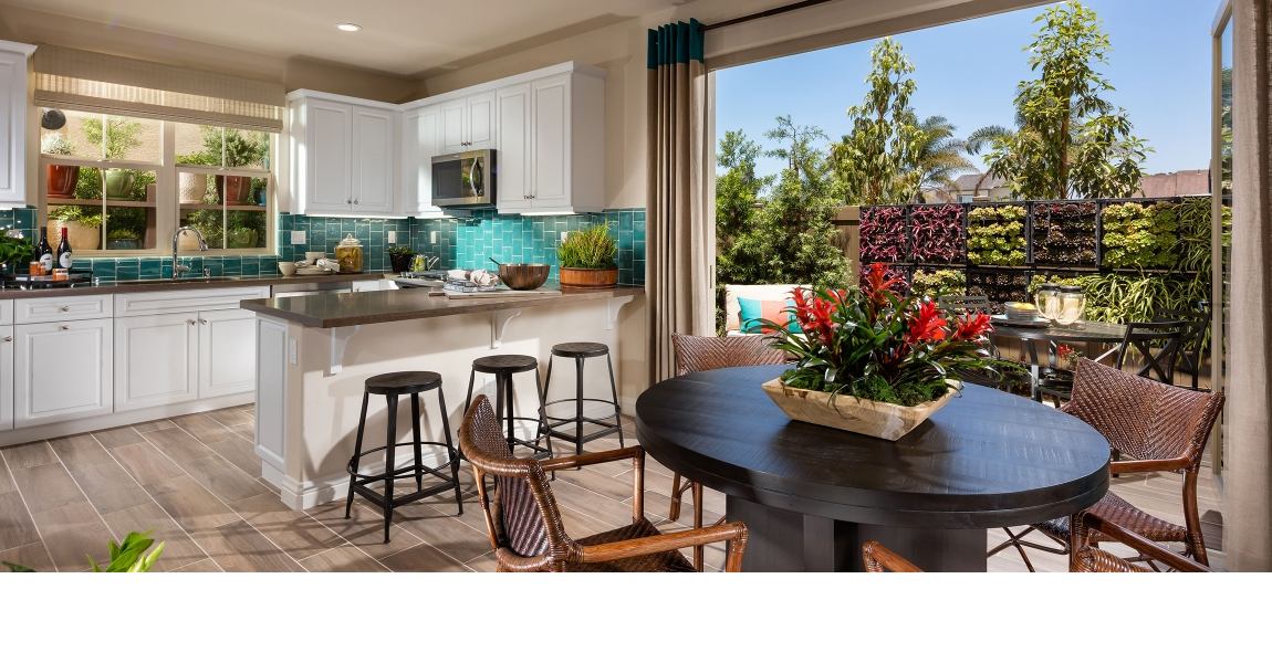 Kitchen and dining room with outside garden wall